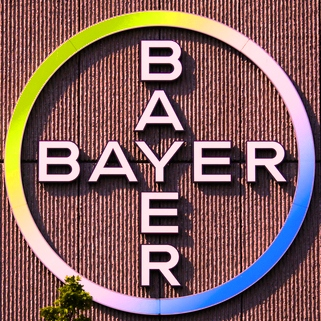 The Bayer AG corporate logo is displayed on a building of the German drug and chemicals company in Berlin, Germany, Monday, May 23, 2016. German drug and chemicals company Bayer AG announced Monday, May 23, 2016 that it has made a US$ 62 billion offer to buy U.S.-based crops and seeds specialist Monsanto. The proposed combination would create a giant seed and farm chemical company with a strong presence in the U.S., Europe and Asia. (AP Photo/Markus Schreiber)